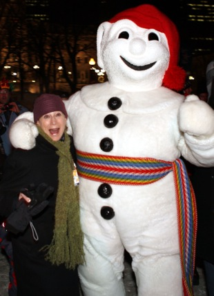 Travel writer Claudia Carbone with Bonhomme, the ambassador of the Quebec City Winter Carnival